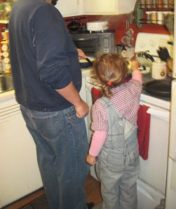 Helping Daddy Man cook.  Or as Itty Bitty says coo-k