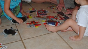 Itty Bitty and Mini Moose disagree over how to put together a floor puzzle!